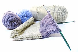 Knitting needles and yarn.