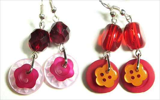 Long red dangle earrings with cute flower buttons and colorful beads