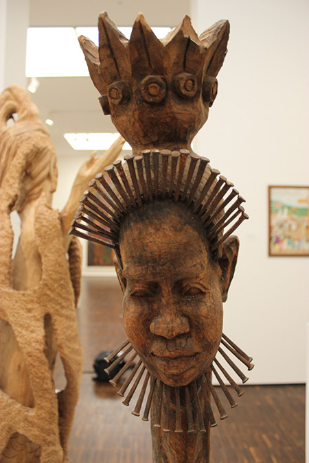 Photograph close up of African art wood carving face at the Figge Museum.