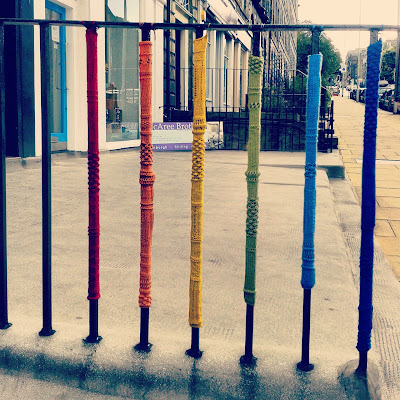 knitted rainbow railing cosies