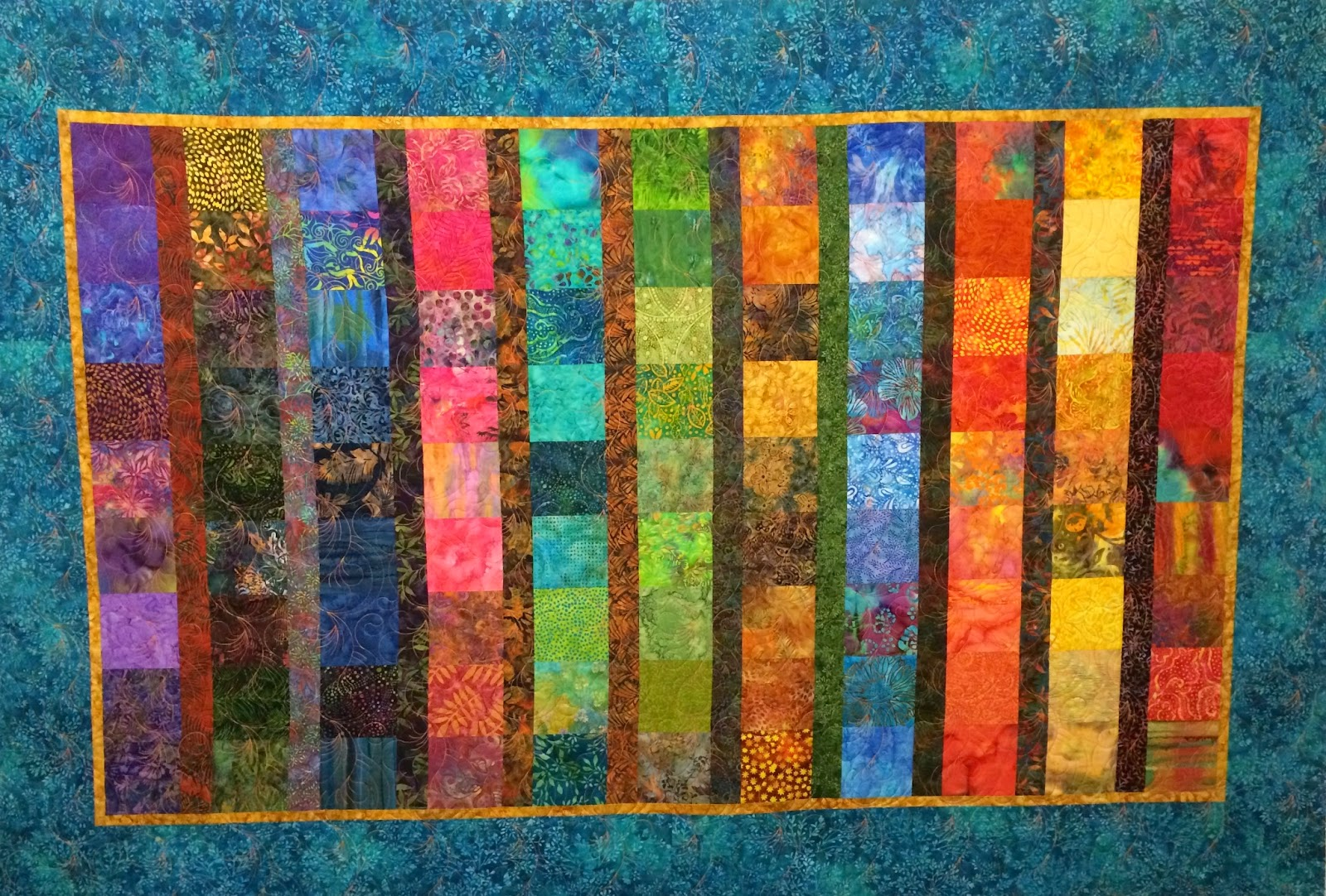 Sally Krebs Batiks in a Row Quilt
