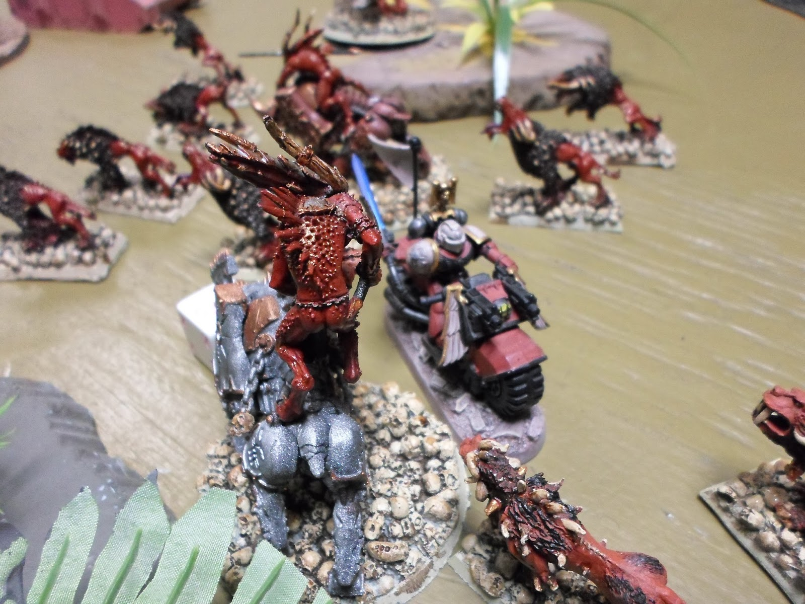 The Blood Raven Chapter Master on bike challenges one of the Blood Crushers