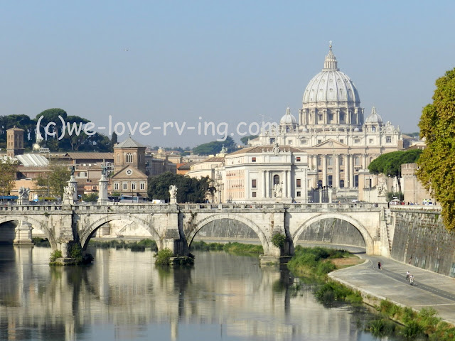 We look down the Tiber River to see St. Peter's Basilica