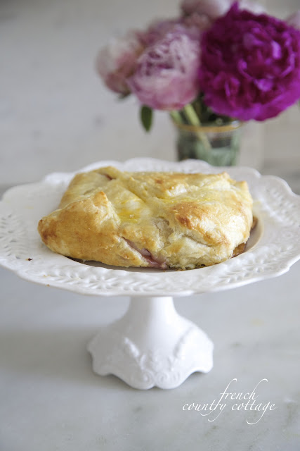 Baked brie in pastry on pedestal
