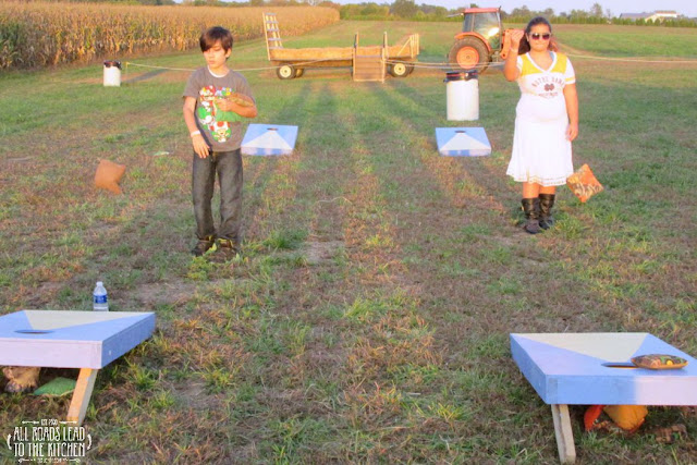 Playing corn hole at the corn maze.