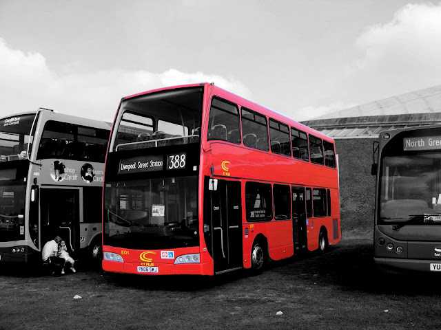 London Bus in show Black and white with Color Photo