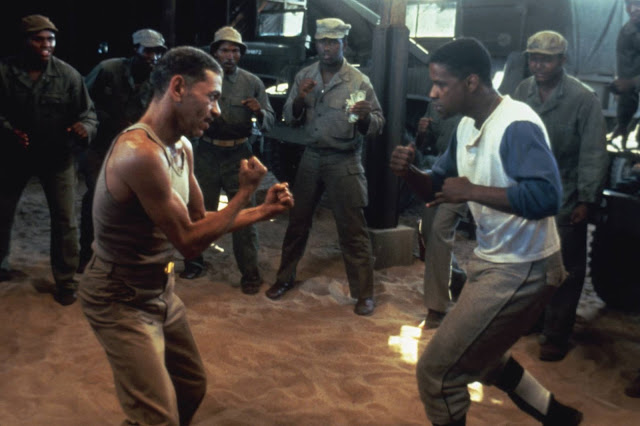 Adolph Caesar attempts to beat up Denzel for making him sit through Virtuosity.