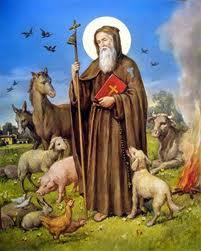 San Antonio con habito y baston con campanillas rodeado de animales