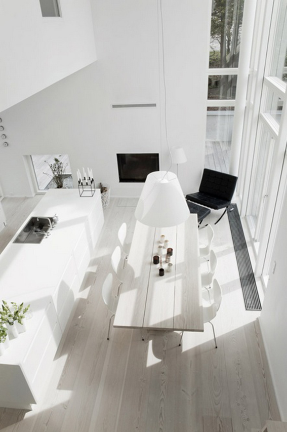 white dinning room with wooden floor
