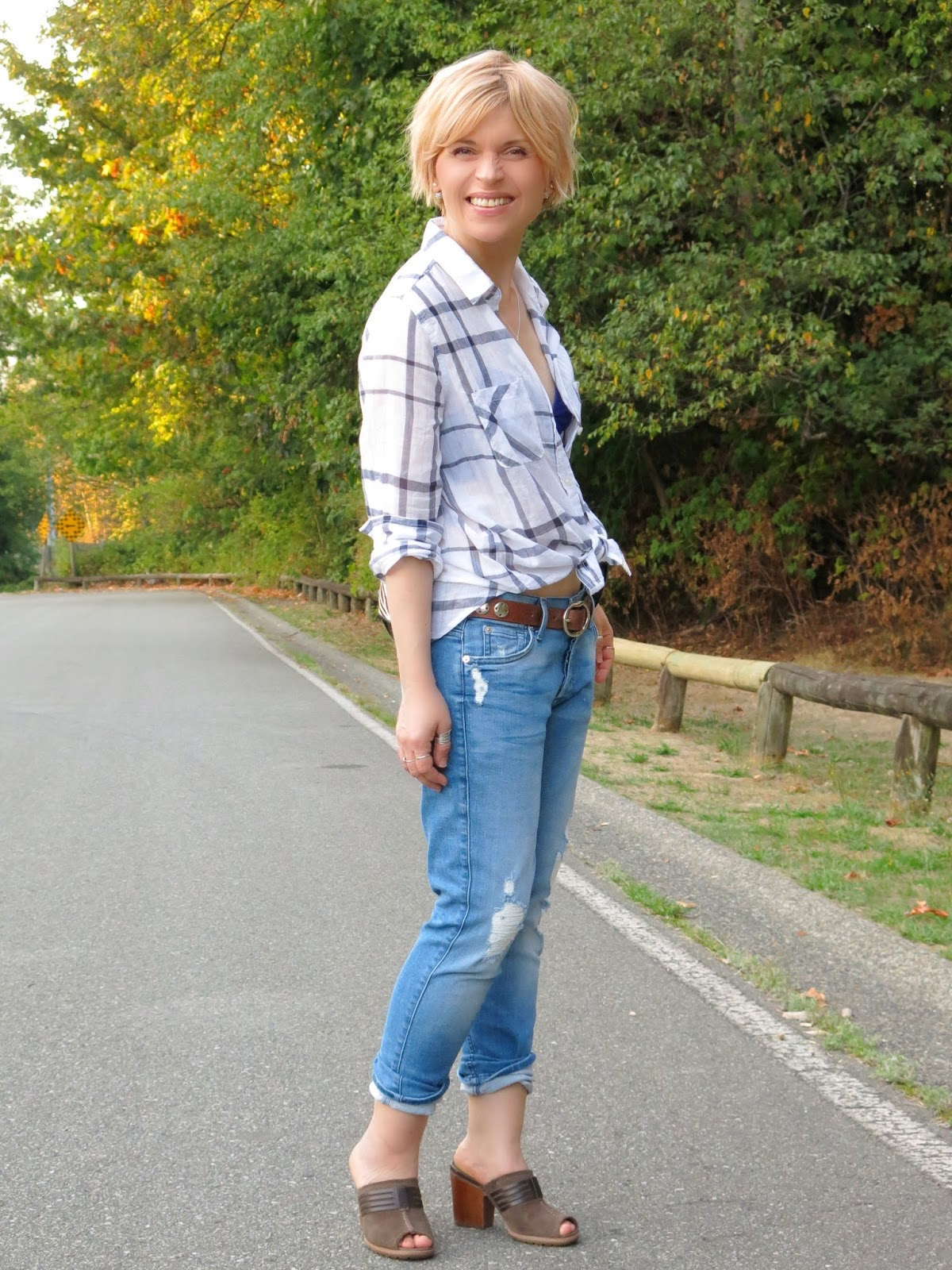 styling a white plaid shirt with boyfriend jeans and block-heeled Timberland mules
