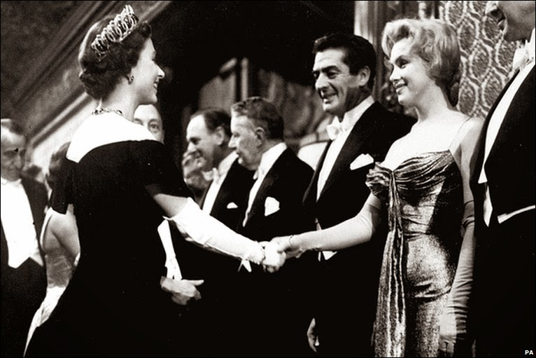 Marilyn Monroe and Queen Elizabeth meet at a movie premiere in London. Date October 1956.