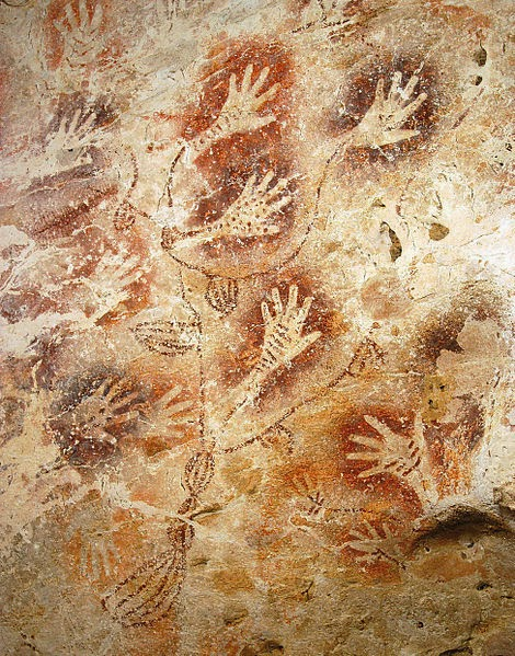 Hand print cave paintings.