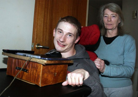 Gareth and Mum, Jacqueline Garratt, in front of his game controller, a Toshiba Mouse on raised box to bring it to a comfortable chin level.