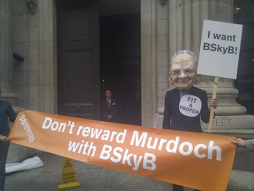 38 Degrees members appear - campaigning to stop Murdoch taking control of BSkyB in the UK after Murdoch's phone hacking scandal. (Photo by 38 Degrees)