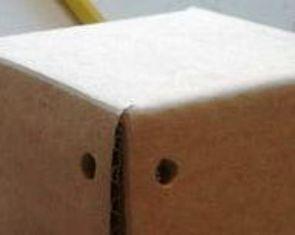 Membuat lubang ikatan pada box