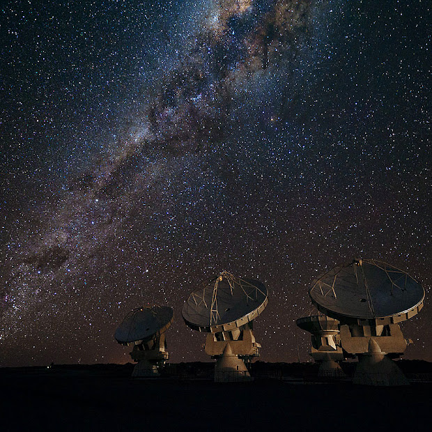 Four ALMA antennas on Chajnantor under the Milky Way