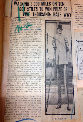 News clipping with photo of man on stilts