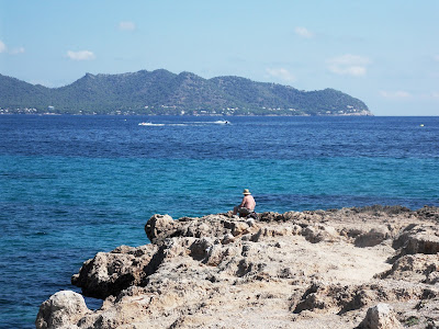 Fisherman on headland at Cala Bona, Mallorca