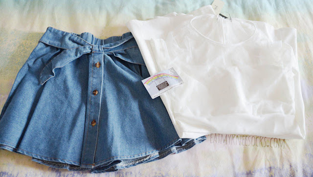 My order from Yumart contained a denim waist bow button skirt and white polka dot mesh dress, both from Tokyo Fashion, a Taiwan clothing brand.