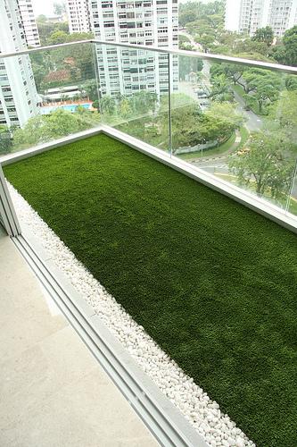 Stormtrooper interior design balcony artificial grass for Balcony artificial grass