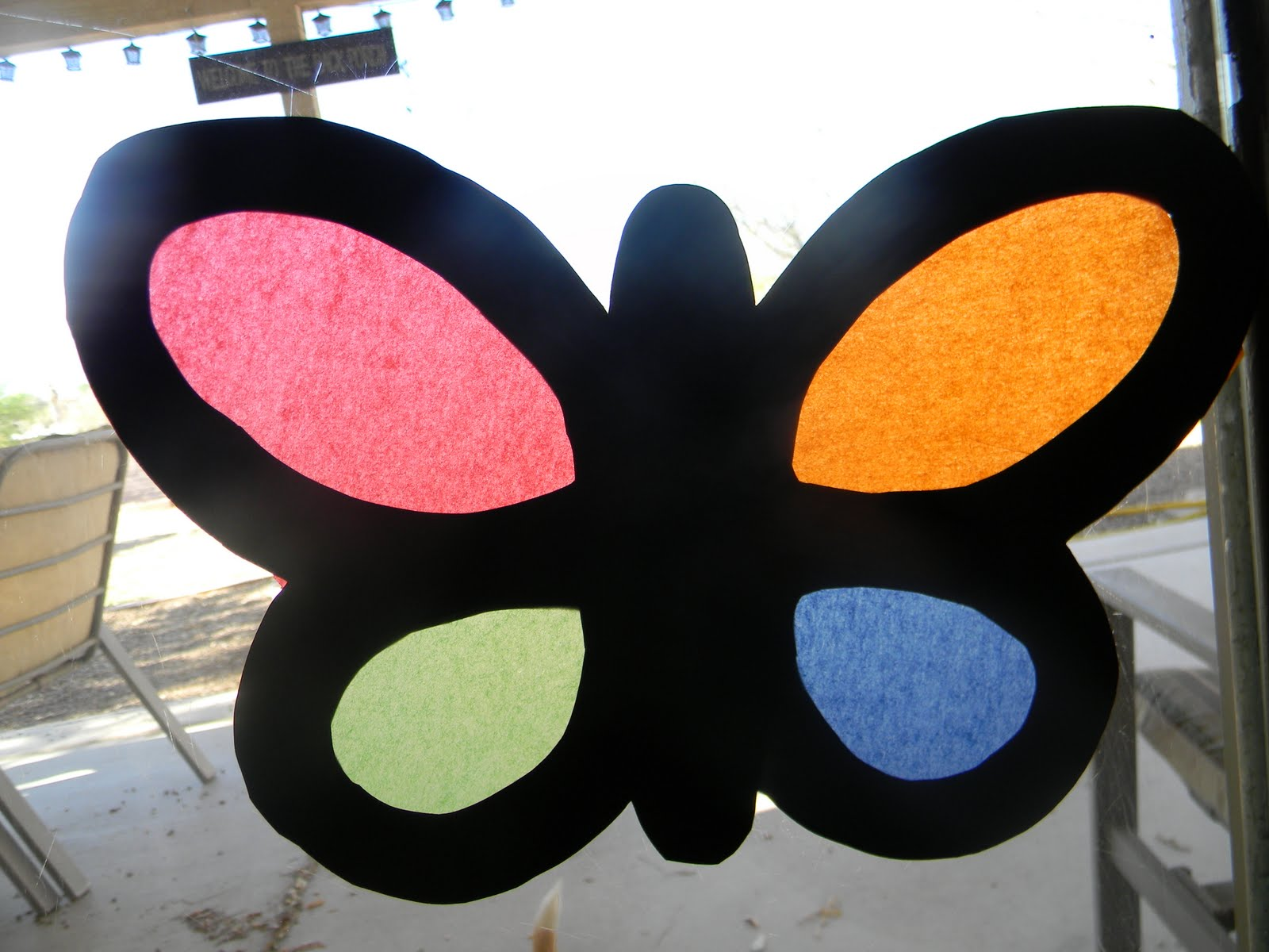 Simply crafty stained glass butterflies this adorable craft is super easy for the kiddos minimal work for the mamas and requires very little supplies black construction paper jeuxipadfo Image collections