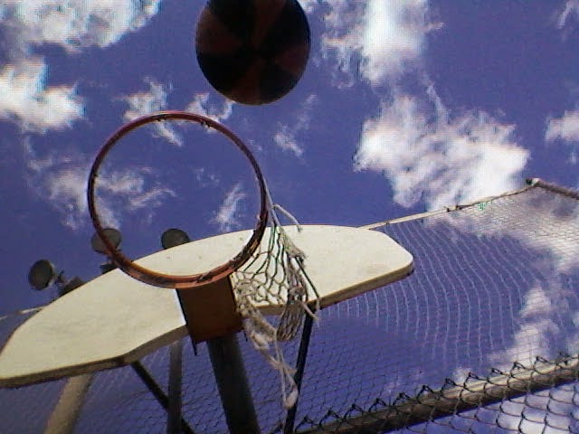 Stock photo: Basketball going through net (outdoor with sky in background)