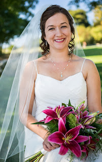 Alisha with a bouquet of stargazer lilies - Patricia Stimac,Seattle Wedding Officiant