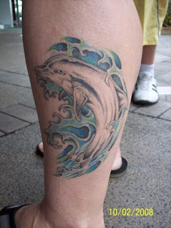 Dolphin Tattoo design Photo Gallery - Dolphin Tattoo Ideas