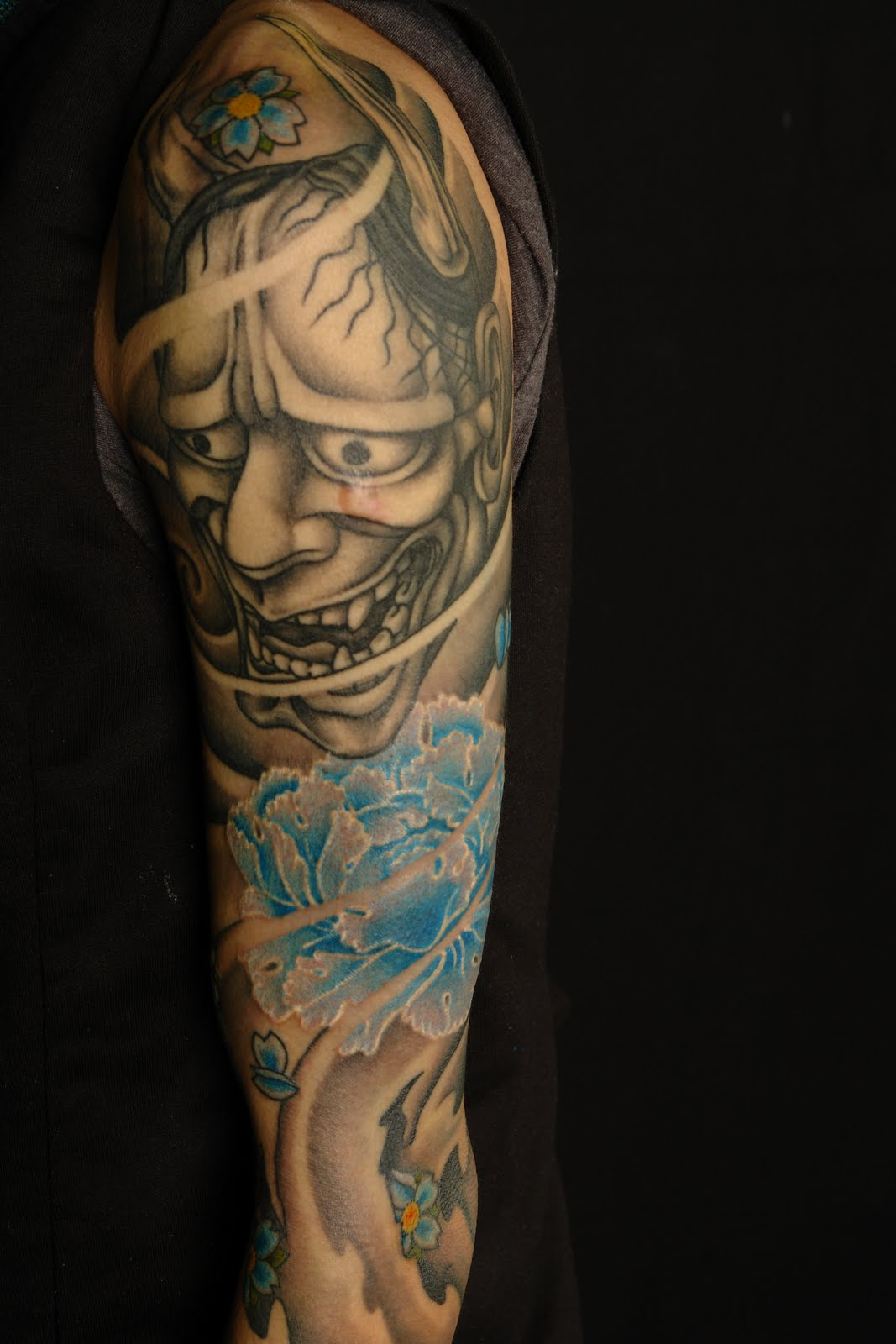 Tattoos for men 2011 japanese sleeve tattoos the for Ideas for half sleeve tattoos for men