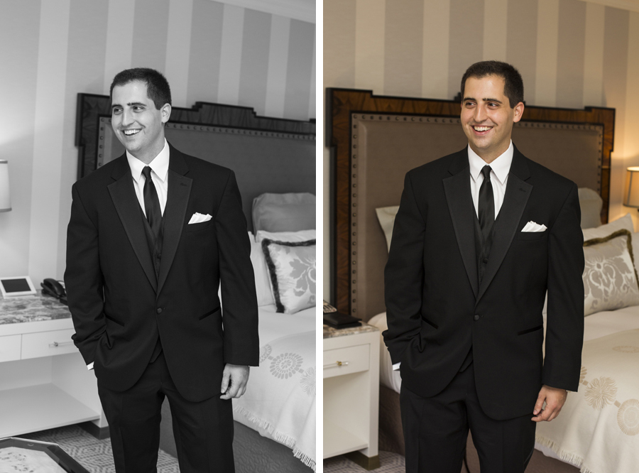 happy candid groom in suit at New York Palace hotel room