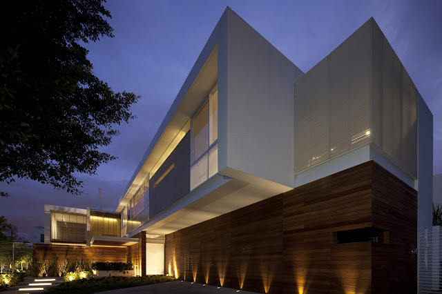 Lighted modern facade of FF House in Mexico