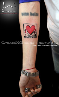 Keith haring finger tattoo