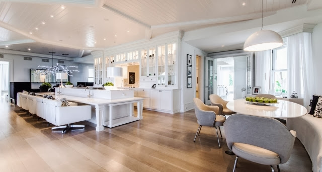Kitchen and Dining room in Celine Dion's home with light wood floor and modern furniture