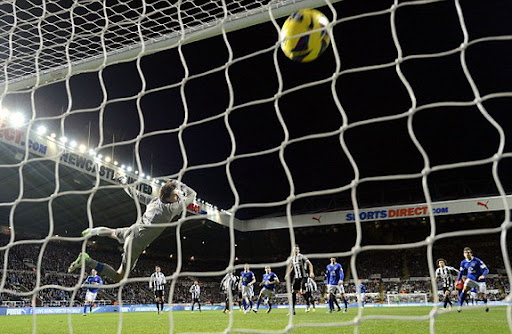 Newcastle goalkeeper Tim Krul has no chance with a free-kick by Everton's Leighton Baines