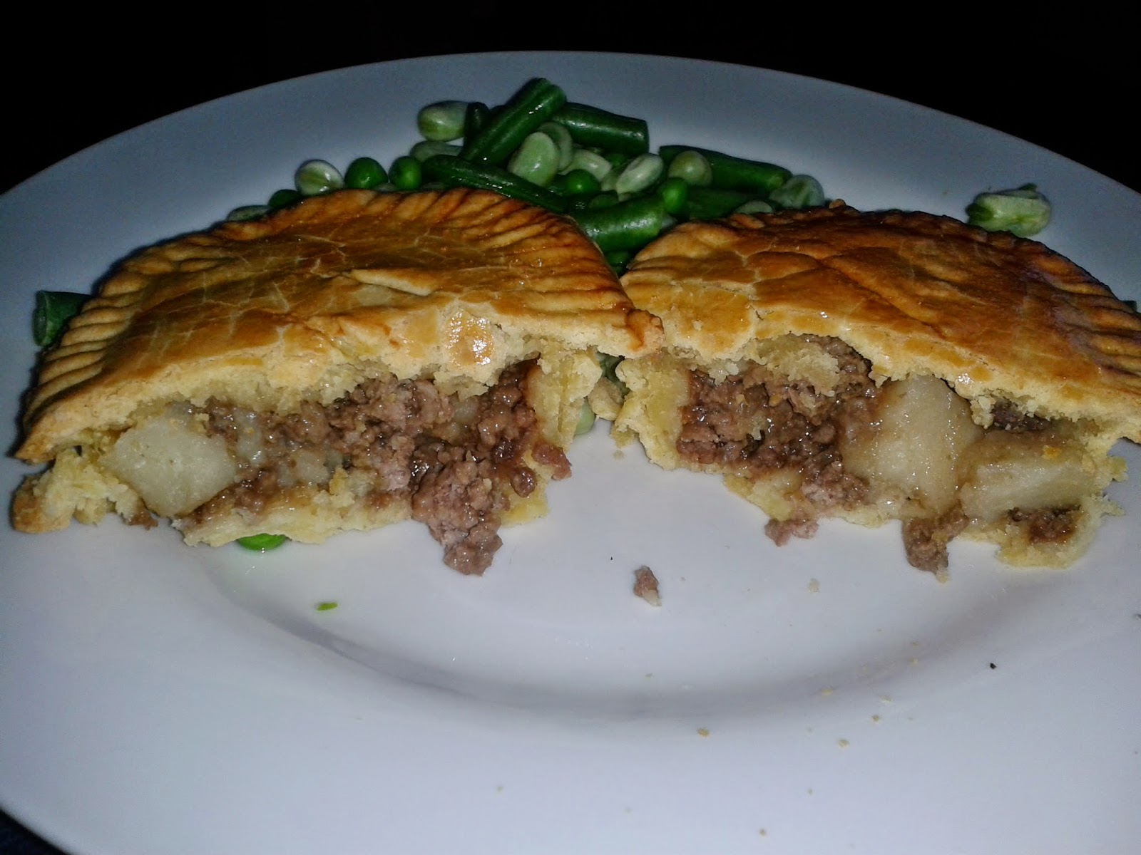 Meat and Potato Pie cut in half