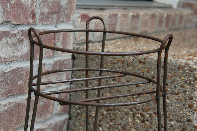 rusted plant stand gets spray paint makeover