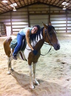 Me hugging my horse's neck from horseback