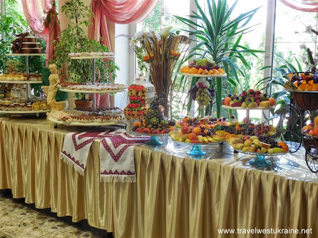 Desserts and fruits table at West Ukrainian wedding