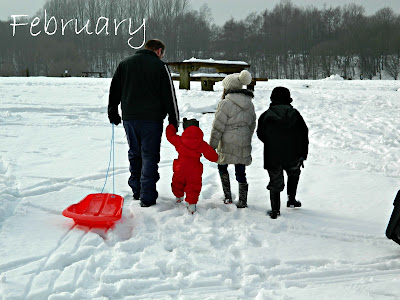 Family playing snow crompton lodges moses gate country park