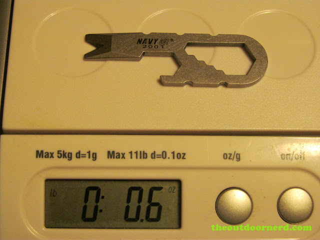 Navy CUI 2001 Keychain Tool being weighed on the scale