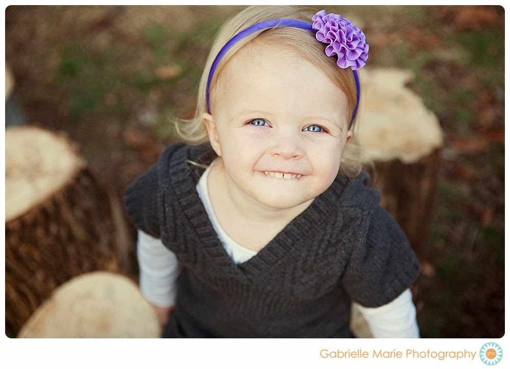 Little girl with bright blue eyes and purple flower headband