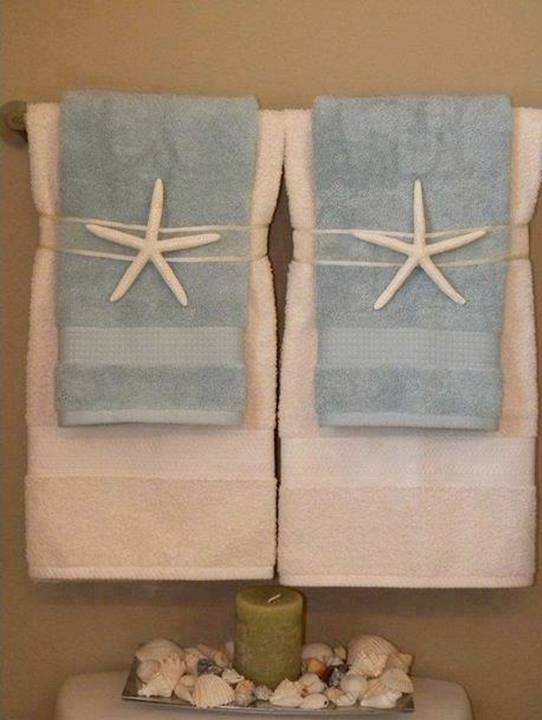 Home decor 15 diy pretty towel arrangements ideas for How to tie towels in bathroom