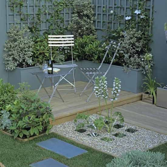 ideias jardins grandes:Um recanto para estar enquadrado por canteiros e plantações