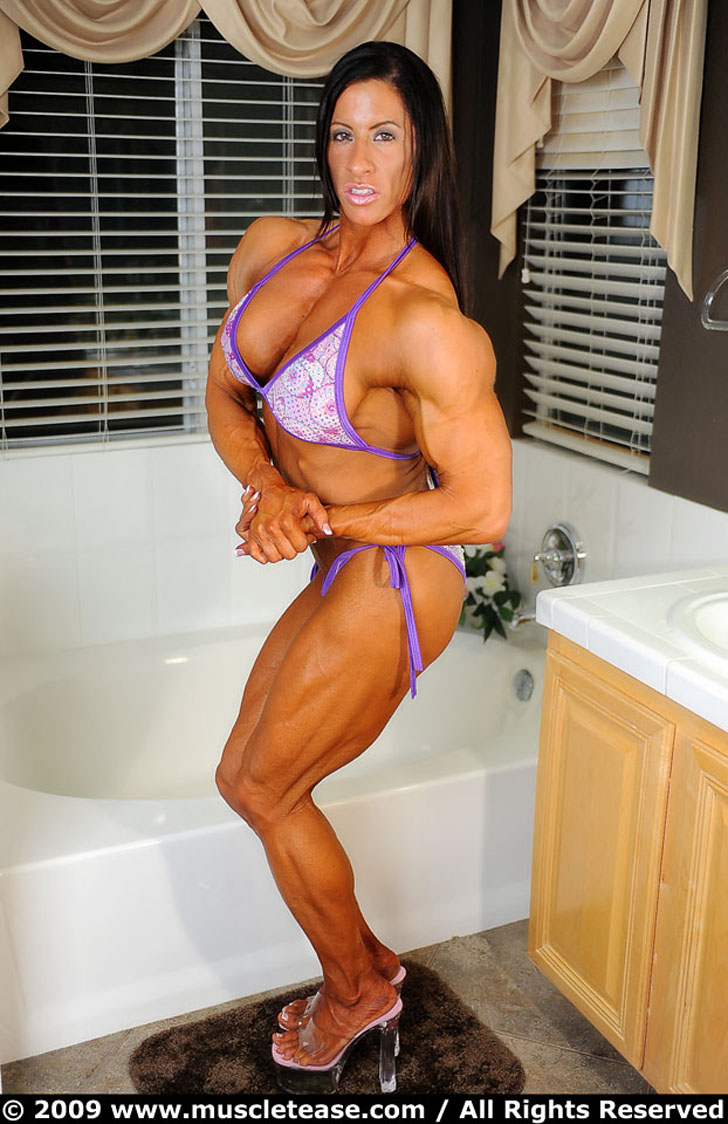 Angela Salvagno Flexing Her Shredded Muscles In A Purple Bikini