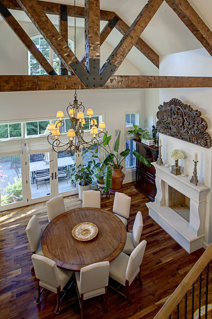 Interesting Round Dining Tables in the Space with Cozy Chairs and Iron Chandelier above Hardwood Floor