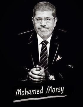 فيديو محاكمة مرسى داخل القفص الزجاجى 28 يناير2014 1069919_547878405247639_1262805084_n