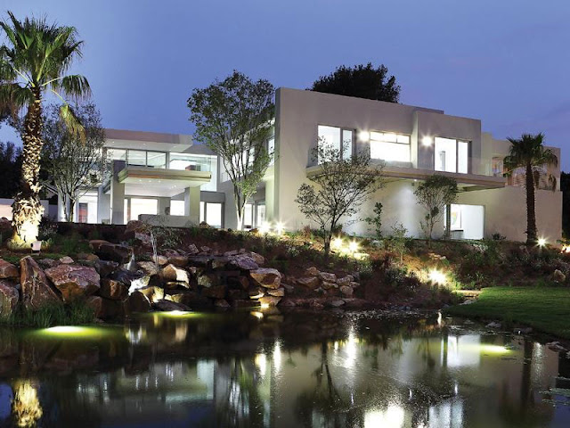 Modern Luxury House In Johannesburg at night from the lake