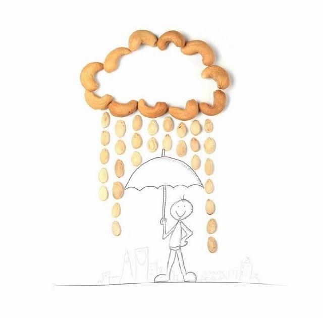 سعودي يرسم شمسية بالقلم وعليها سحاب ومطر بواسطة المكسرات