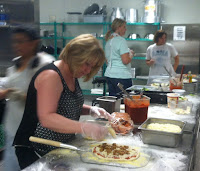 image of students prepping pizzas at RSC Cafe @ Rio