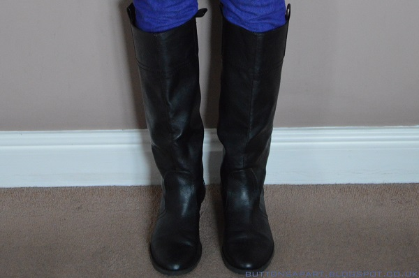 a picture of black knee high boots
